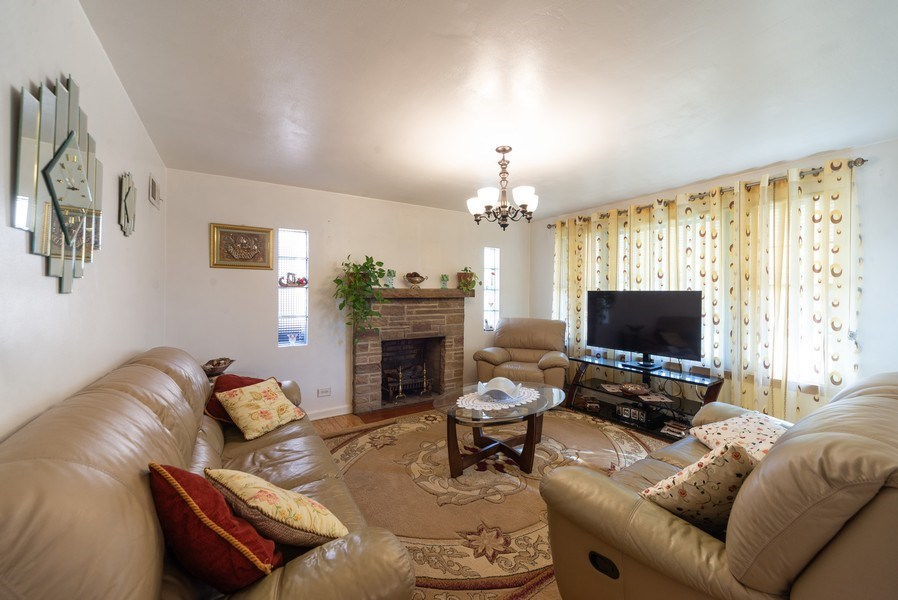 Real Estate Photography - 2924 Lincoln St, Franklin Park, IL, 60131 - Living Room