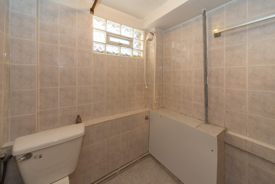 Real Estate Photography - 2924 Lincoln St, Franklin Park, IL, 60131 - 2nd Bathroom