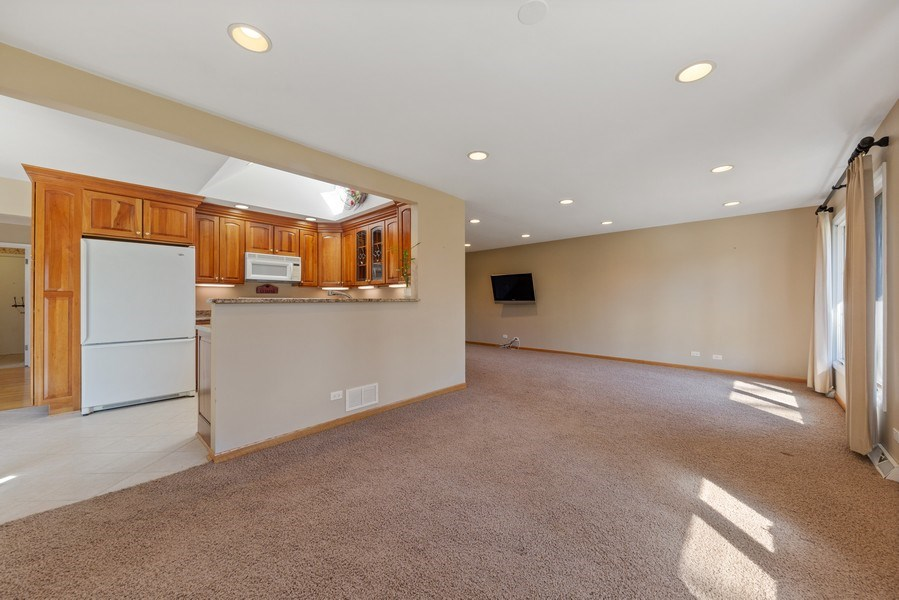 Real Estate Photography - 3811 Candlewood Ct, Downers Grove, IL, 60515 - Dining and Living Room with Open Kitchen