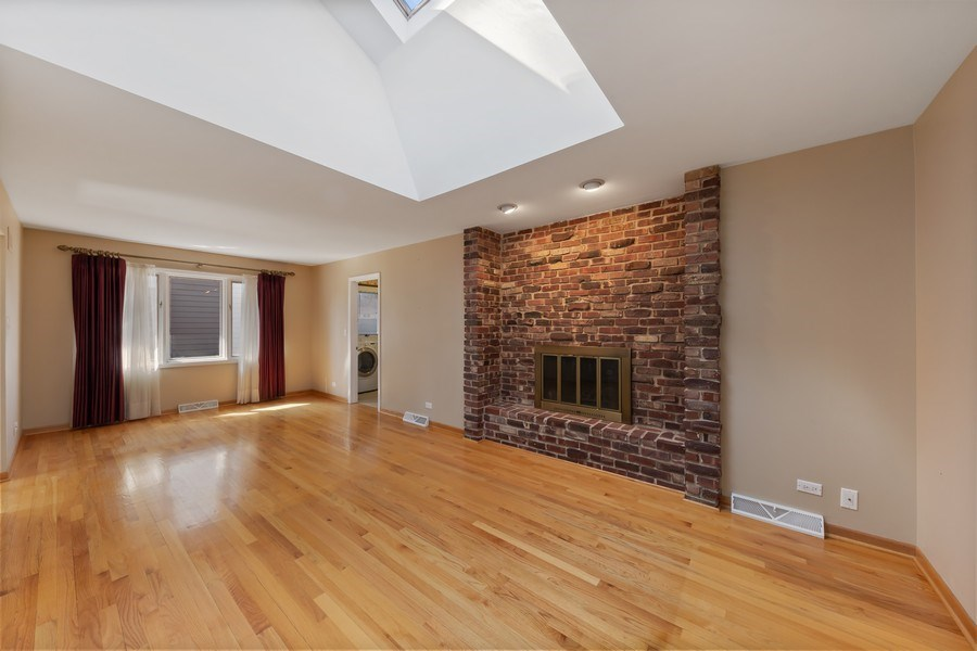 Real Estate Photography - 3811 Candlewood Ct, Downers Grove, IL, 60515 - The Vaulted Family Room with Skylight