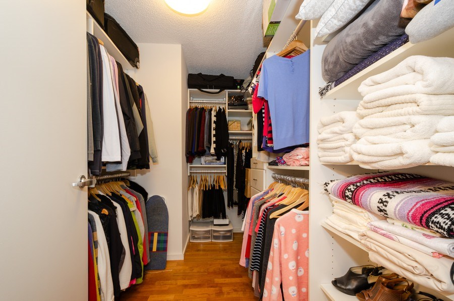 Real Estate Photography - 9725 Woods Dr, 1215, Skokie, IL, 60077 - Master Bedroom Closet