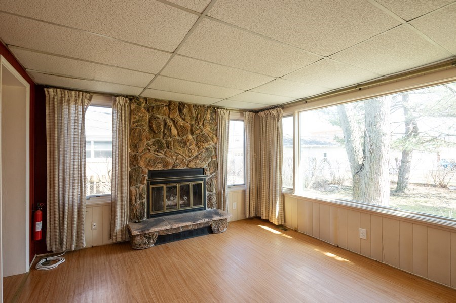 Real Estate Photography - 8019 N. Ozanam Ave, Niles, IL, 60714 - Family Room