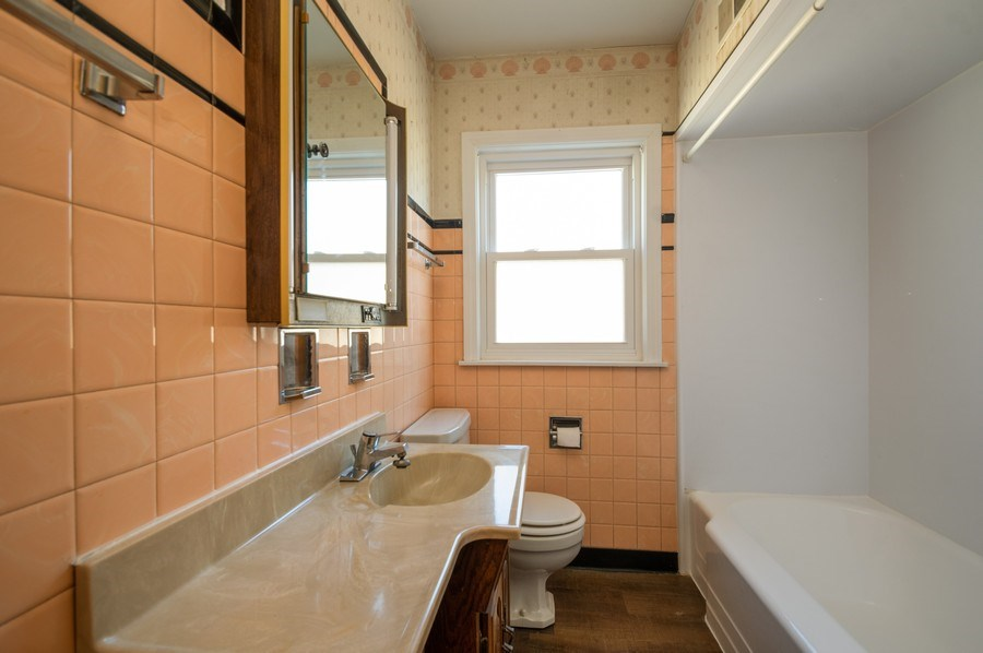 Real Estate Photography - 8019 N. Ozanam Ave, Niles, IL, 60714 - Bathroom