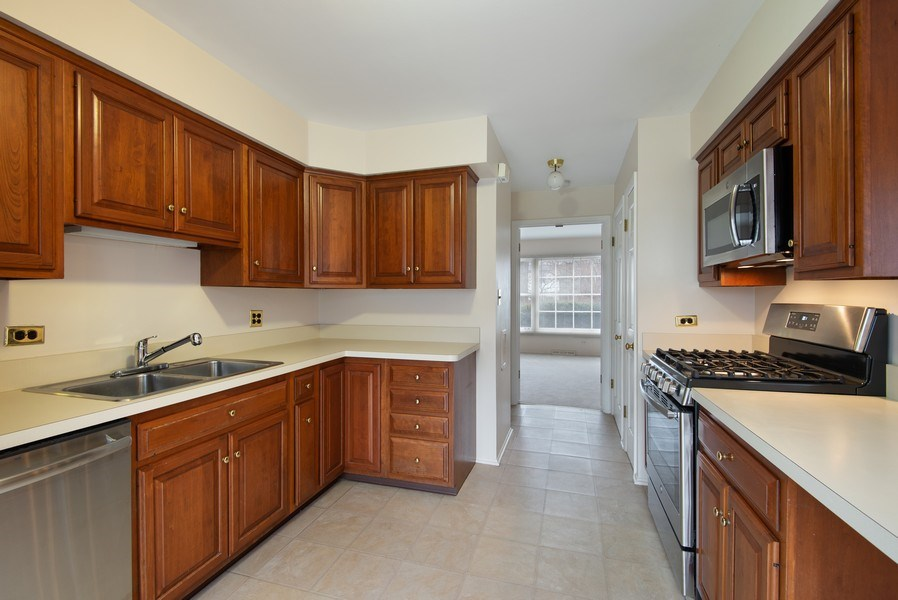 Real Estate Photography - 829 Hibbard Road, Wilmette, IL, 60091 - Galley style kitchen with new SS appliances