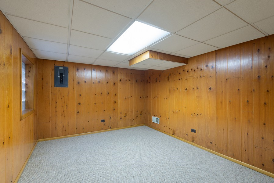 Real Estate Photography - 829 Hibbard Road, Wilmette, IL, 60091 - Lower Level knotty pine office