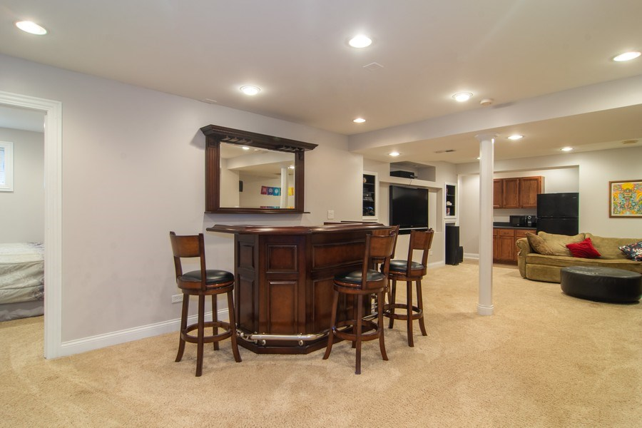 Real Estate Photography - 24815 Wildberry Bend, Cary, IL, 60013 - Lower Level Bar & Rec Room