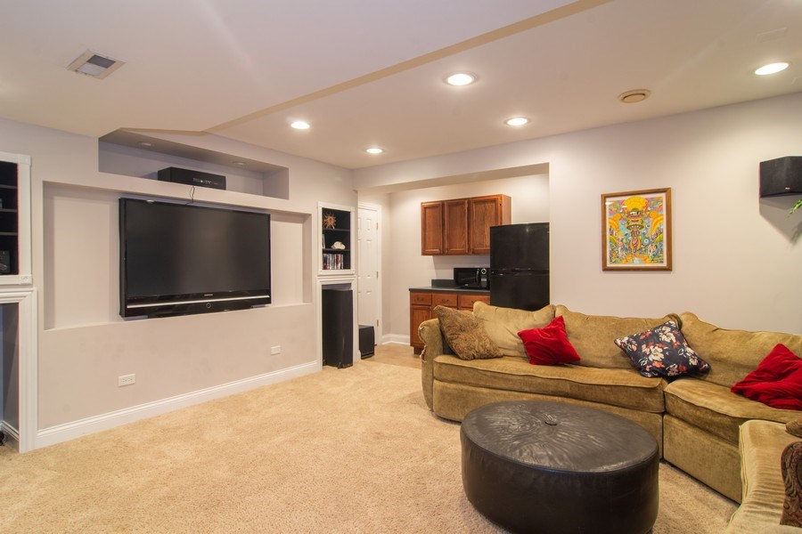 Real Estate Photography - 24815 Wildberry Bend, Cary, IL, 60013 - Lower Level Theatre Area