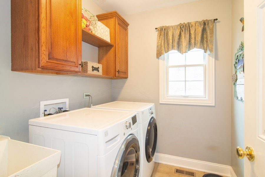 Real Estate Photography - 24815 Wildberry Bend, Cary, IL, 60013 - 1st Floor Laundry
