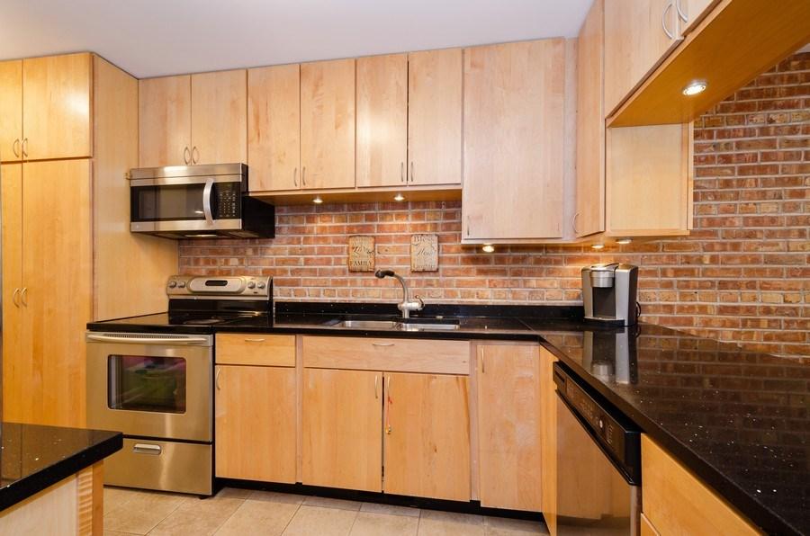 Real Estate Photography - 1100 Pine St. Unit D, Glenview, IL, 60025 - Kitchen