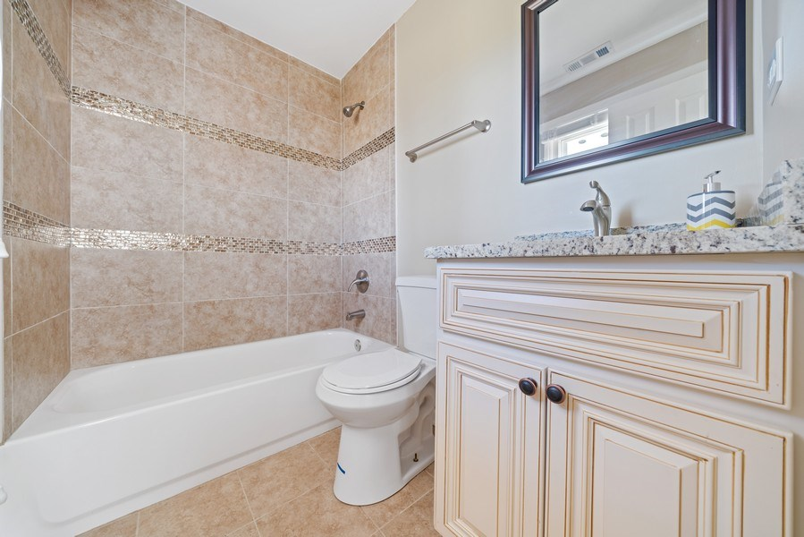 Real Estate Photography - 619 Lincolnwood Dr, Streamwood, IL, 60107 - Master Bathroom