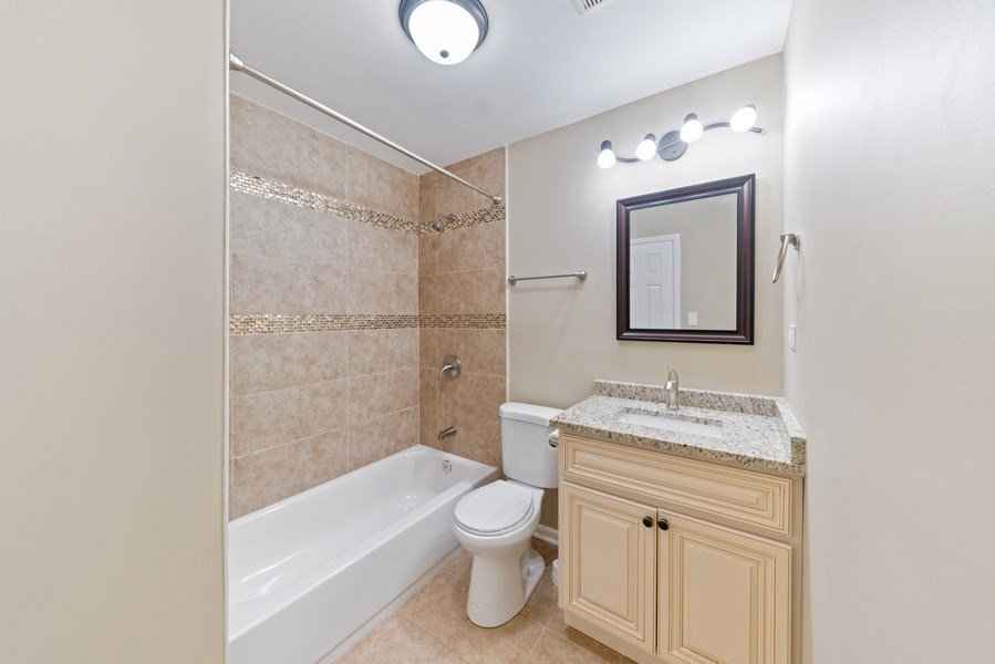 Real Estate Photography - 619 Lincolnwood Dr, Streamwood, IL, 60107 - 2nd Bathroom