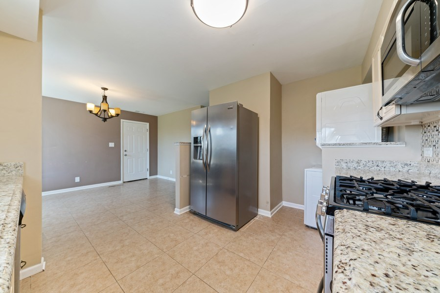 Real Estate Photography - 619 Lincolnwood Dr, Streamwood, IL, 60107 - Family Room / Kitchen