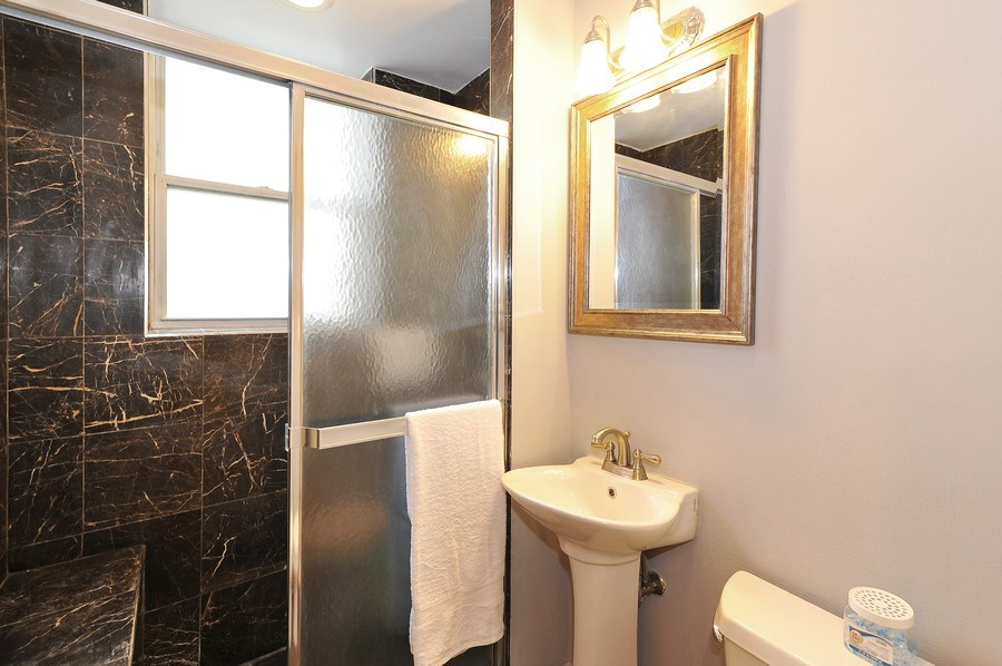 Real Estate Photography - 2539 W Foster Ave, Unit 1, Chicago, IL, 60625 - Bathroom