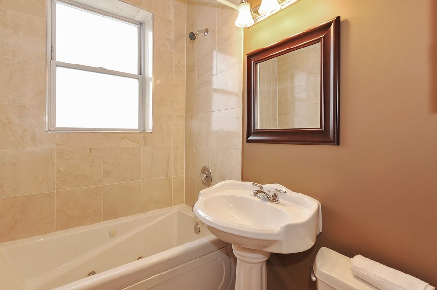 Real Estate Photography - 2539 W Foster Ave, Unit 1, Chicago, IL, 60625 - 2nd Bathroom