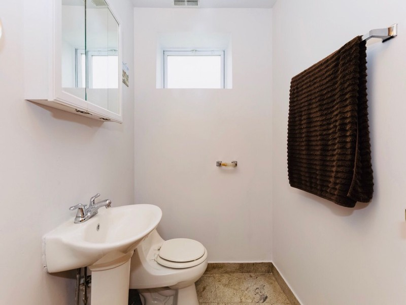 Real Estate Photography - 2539 W Foster Ave, Unit 1, Chicago, IL, 60625 - Lower level powder room