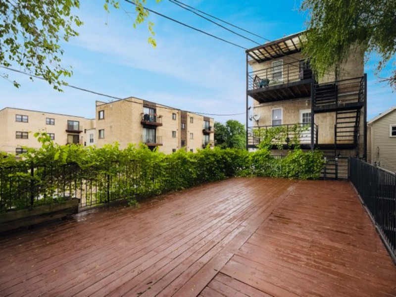 Real Estate Photography - 2539 W Foster Ave, Unit 1, Chicago, IL, 60625 - Rear Large Deck