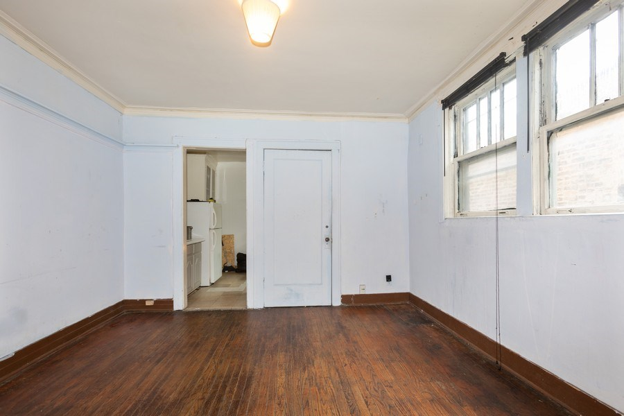 Real Estate Photography - 430 44th St, Chicago, IL, 60653 - Living Room / Dining Room
