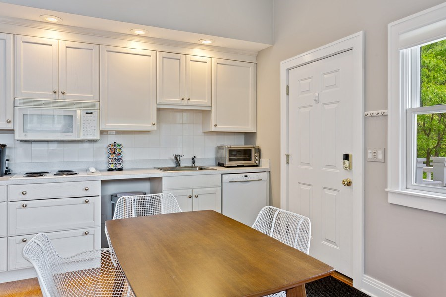 Real Estate Photography - 233 Beachwalk Ln, Michigan City, IN, 46360 - Guest House Dining Room