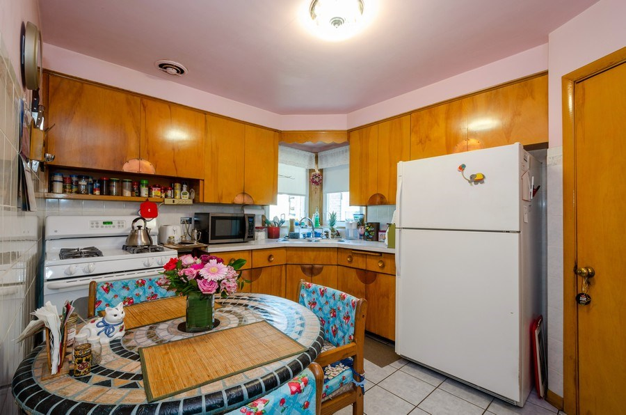 Real Estate Photography - 6231 N. Kildare Avenue, Chicago, IL, 60646 - Kitchen / Breakfast Room