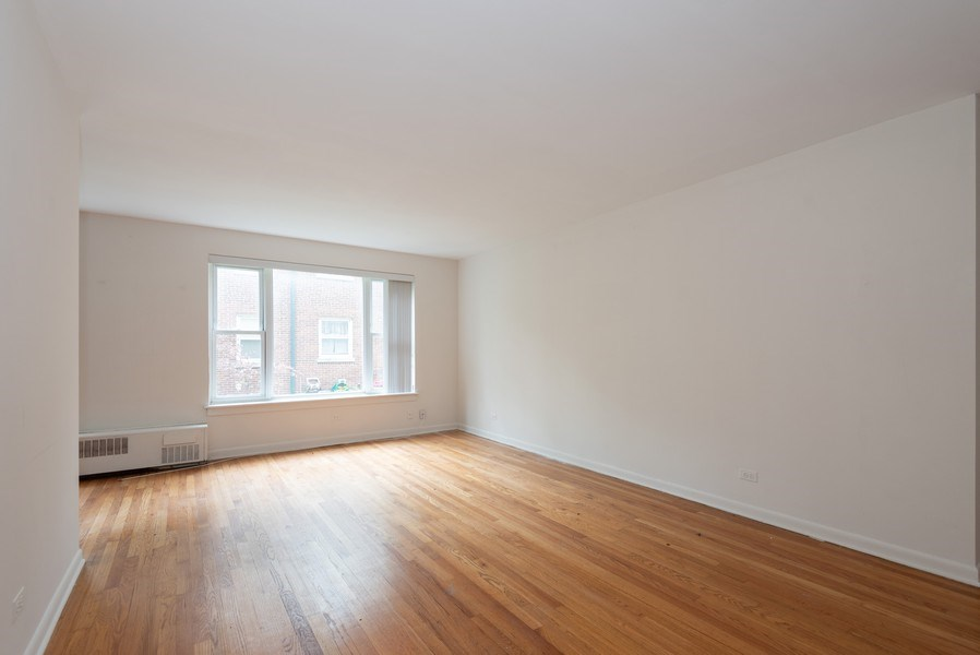Real Estate Photography - 2424 W. Estes Uit 2G, Chicago, IL, 60645 - Living Room