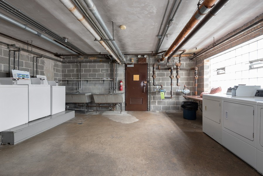 Real Estate Photography - 2424 W. Estes Uit 2G, Chicago, IL, 60645 - Laundry Room