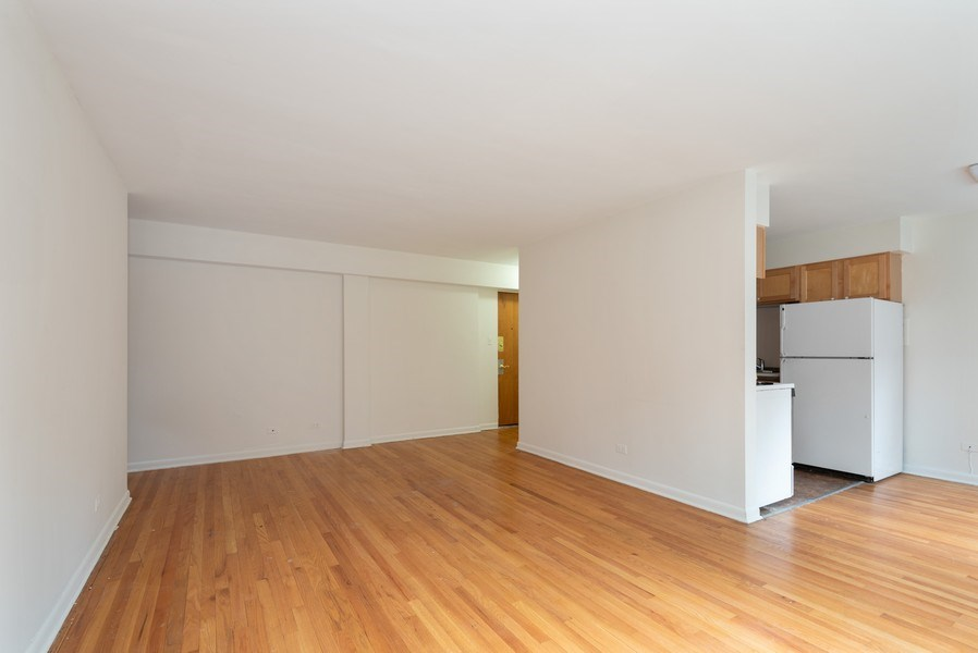 Real Estate Photography - 2424 W. Estes Uit 2G, Chicago, IL, 60645 - Kitchen / Living Room