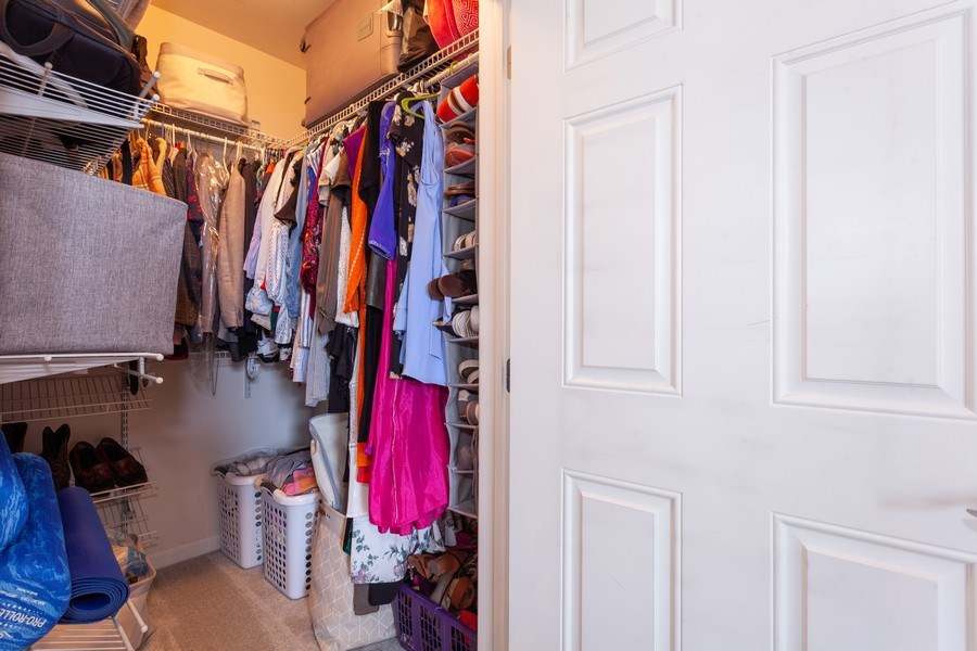 Real Estate Photography - 930 Curtis St., Unit 309, Downers Grove, IL, 60515 - Master Bedroom Closet