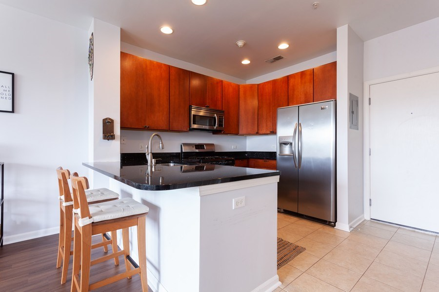 Real Estate Photography - 930 Curtis St., Unit 309, Downers Grove, IL, 60515 - Kitchen