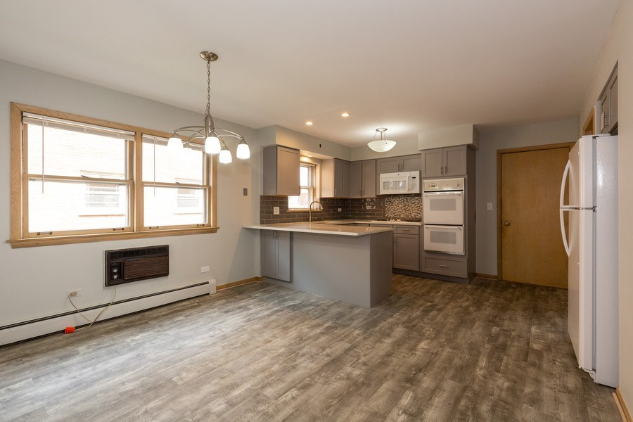Real Estate Photography - 8556 W. Argyle St., Chicago, IL, 60656 - Kitchen / Dining Room