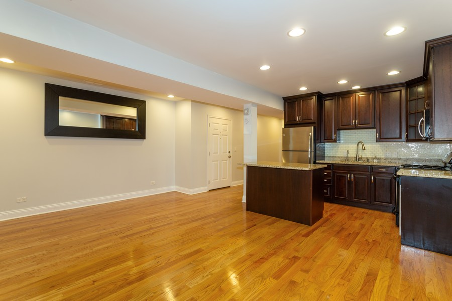 Real Estate Photography - 928 W Eastwood, Unit 1E, Chicago, IL, 60640 - Kitchen / Living Room