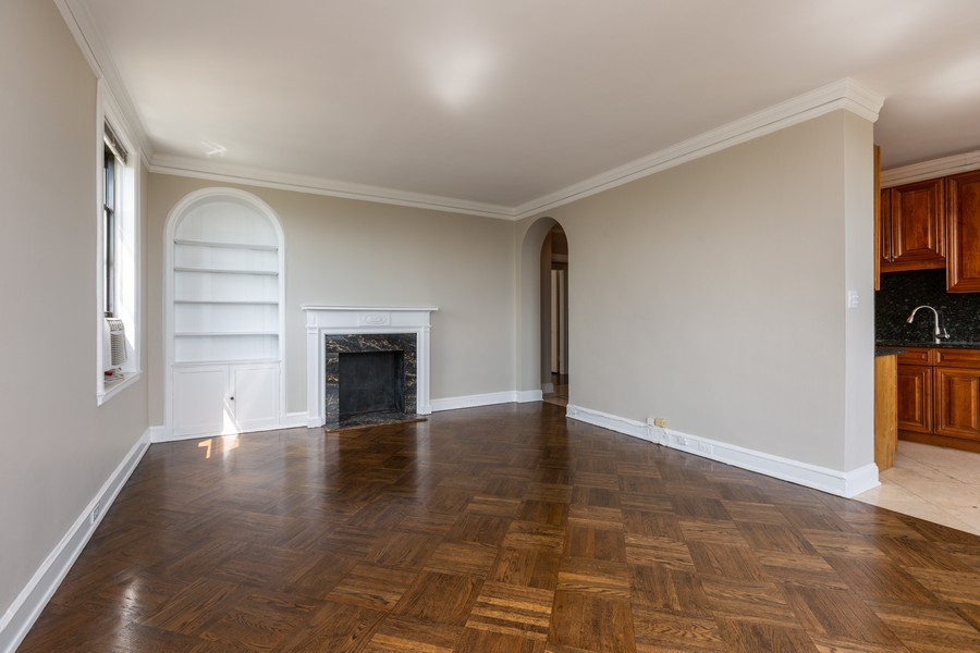 Real Estate Photography - 2000 Lincoln Park West Unit 902, Chicago, IL, 60614 - Living room complete with millwork, fireplace and