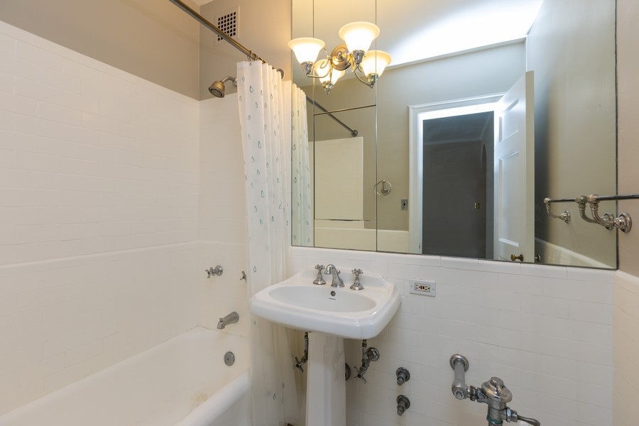 Real Estate Photography - 2000 Lincoln Park West Unit 902, Chicago, IL, 60614 - Vintage touches throughout to the bathroom.