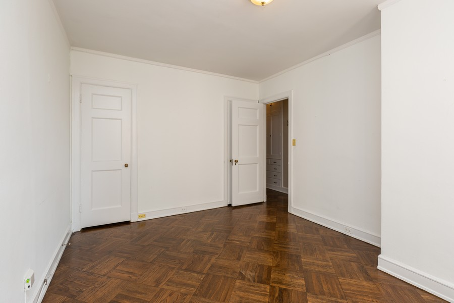 Real Estate Photography - 2000 Lincoln Park West Unit 902, Chicago, IL, 60614 - Second bedroom with spacious closet.