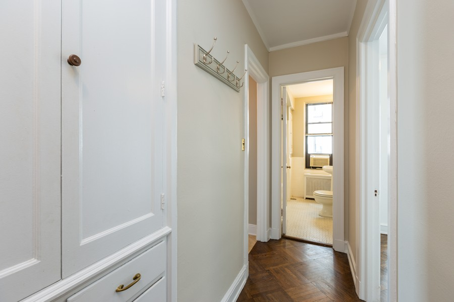Real Estate Photography - 2000 Lincoln Park West Unit 902, Chicago, IL, 60614 - Hallway with cedar closets providing fabulous stor
