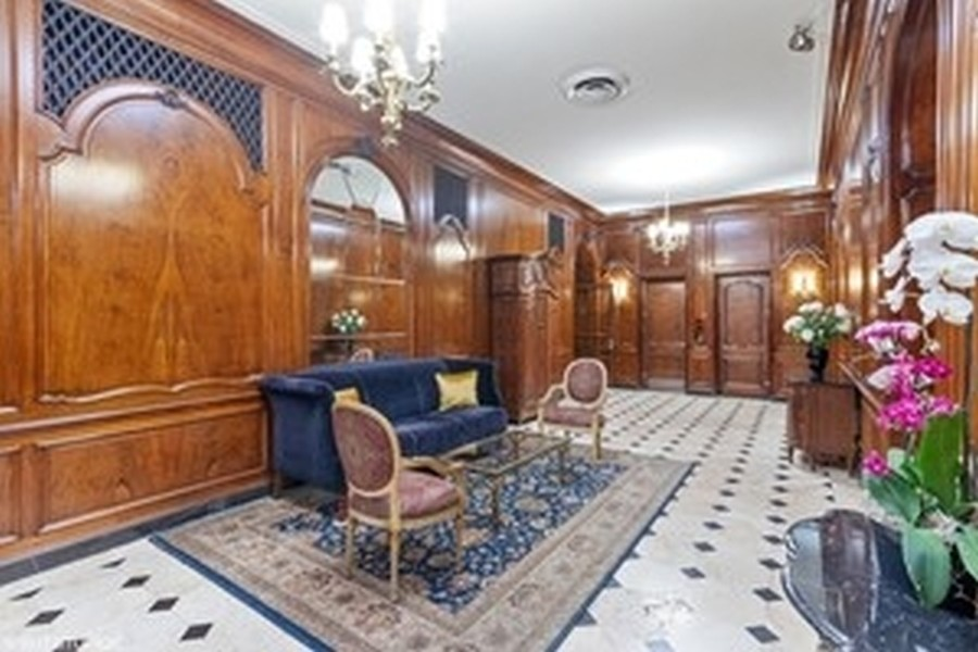 Real Estate Photography - 2000 Lincoln Park West Unit 902, Chicago, IL, 60614 - Stately lobby of 2000 LPW.