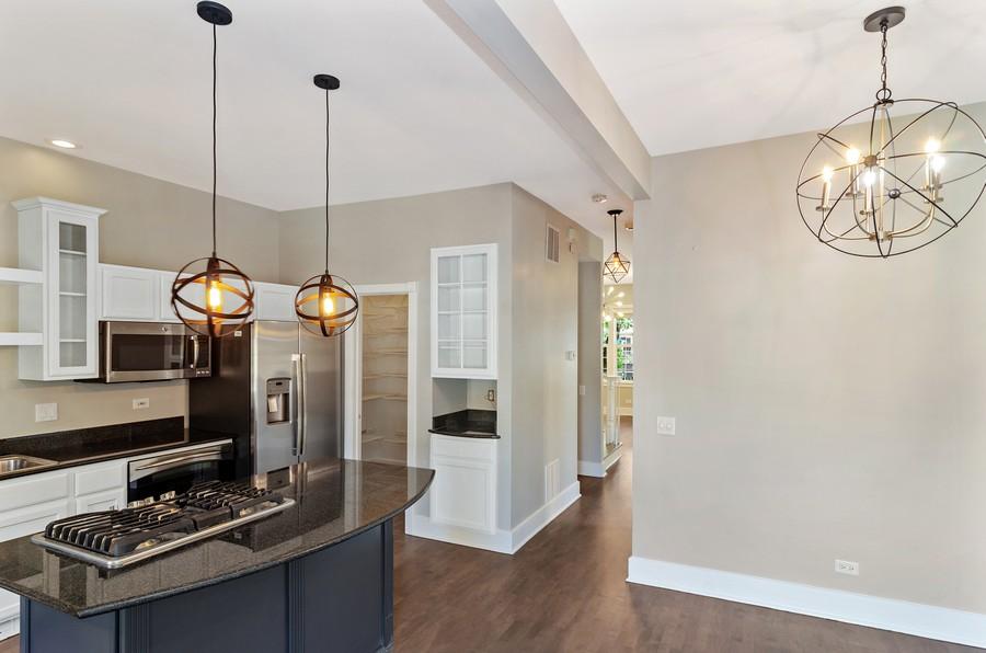 Real Estate Photography - 3545 N Damen, Chicago, IL, 60618 - Kitchen Peeking into hallway with Powder Room