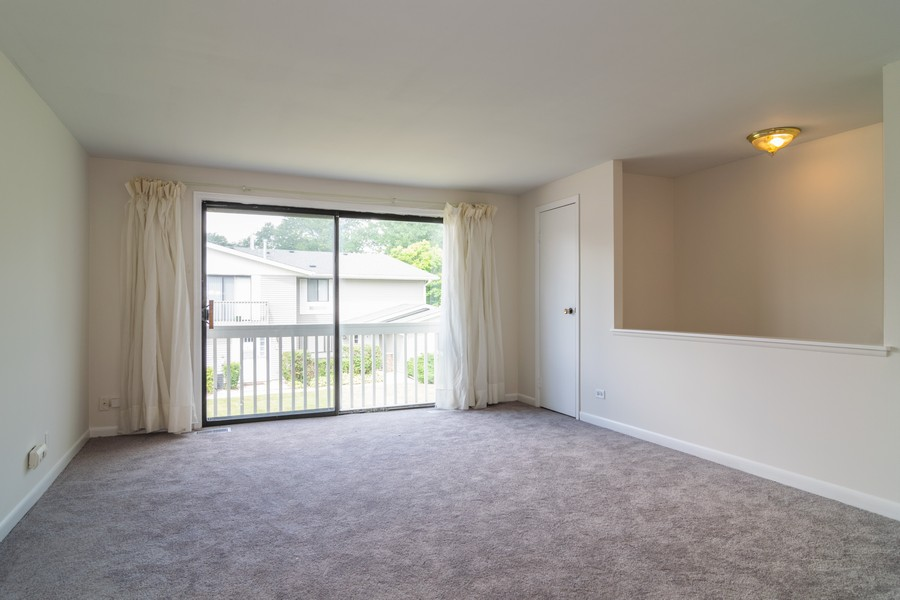 Real Estate Photography - 135 Fairlane, Unit A, Bloomingdale, IL, 60108 - Living Room