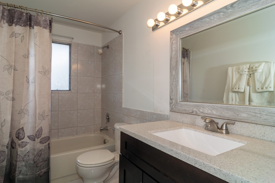 Real Estate Photography - 135 Fairlane, Unit A, Bloomingdale, IL, 60108 - Bathroom