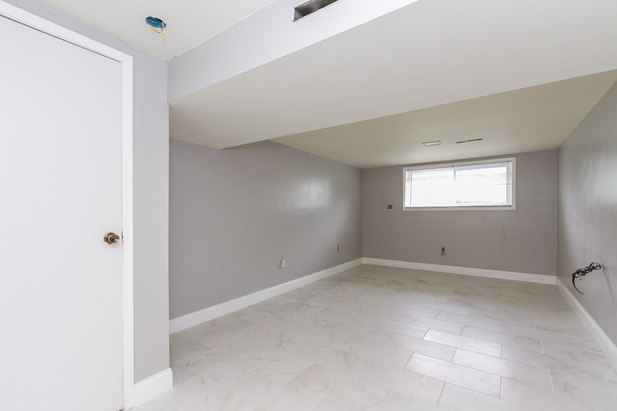 Real Estate Photography - 500 E 78th Pl, Merrillville, IN, 46410 - Family Room