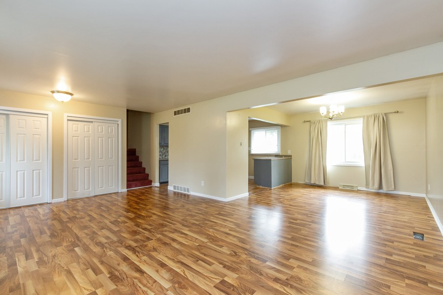 Real Estate Photography - 500 E 78th Pl, Merrillville, IN, 46410 - Living Room / Dining Room
