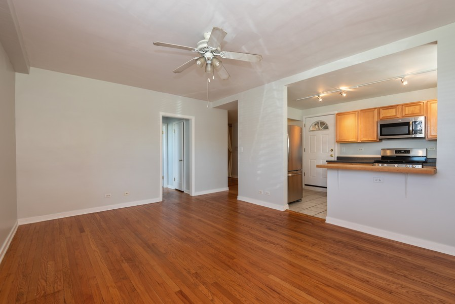 Real Estate Photography - 2732 Hampton Parkway #DG, Evanston, IL, 60201 - Living Room - Kitchen - private entry door