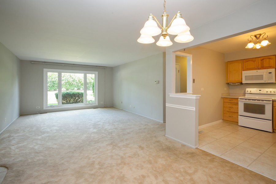 Real Estate Photography - 1314 S. New Wilk Road, Unit 1C, Arlington Heights, IL, 60005 - Kitchen / Living Room