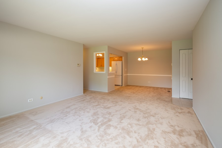 Real Estate Photography - 1314 S. New Wilk Road, Unit 1C, Arlington Heights, IL, 60005 - Living Room / Dining Room
