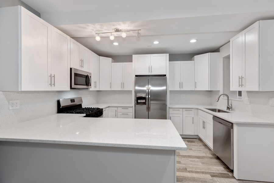Real Estate Photography - 7138 S Cole Ave, Unit 1N, Chicago, IL, 60649 - Kitchen