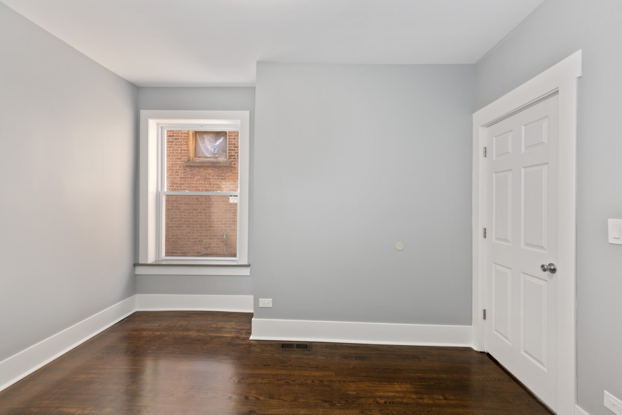 Real Estate Photography - 7138 S Cole Ave, Unit 1N, Chicago, IL, 60649 - Bedroom