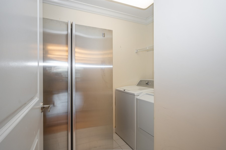 Real Estate Photography - 55 E Erie, Unit 3203, Chicago, IL, 60611 - Laundry Room