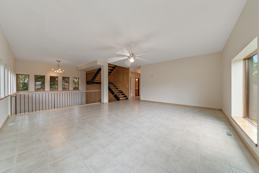 Real Estate Photography - 32 Blodgett Avenue, Clarendon Hills, IL, 60514 - Living Room opens to Basement Great Room