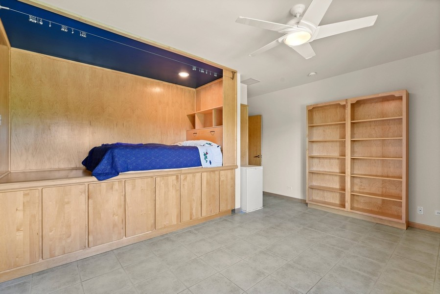 Real Estate Photography - 32 Blodgett Avenue, Clarendon Hills, IL, 60514 - 3rd BR w/built-ins -  from the bed to storage
