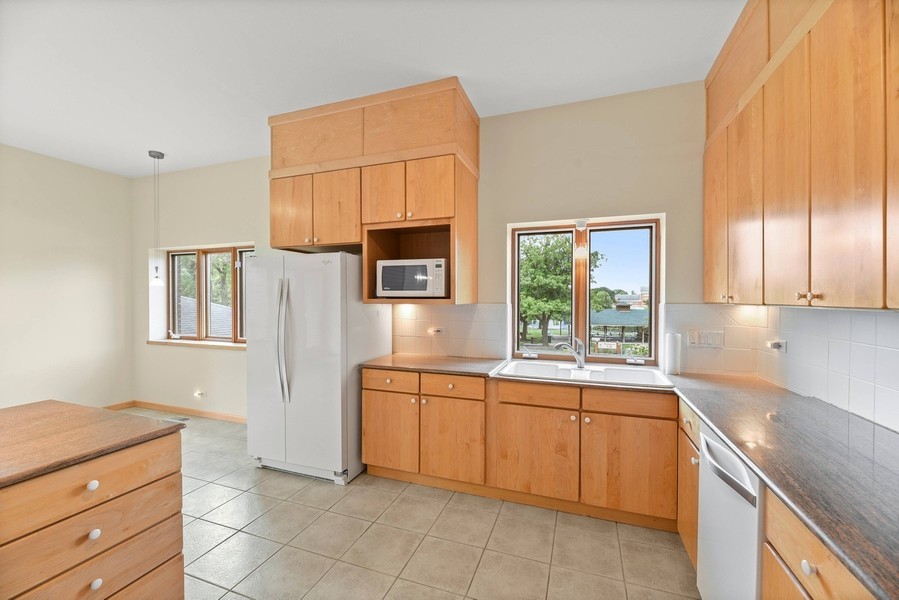Real Estate Photography - 32 Blodgett Avenue, Clarendon Hills, IL, 60514 - Large Kitchen open to DR w/beautiful views