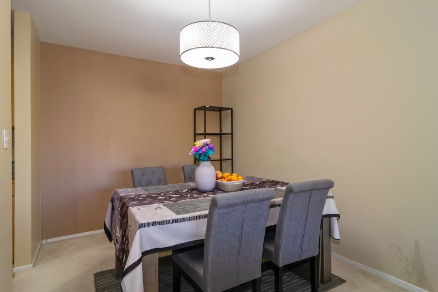 Real Estate Photography - 1931 Prairie Square 223, Schaumburg, IL, 60173 - Dining Room